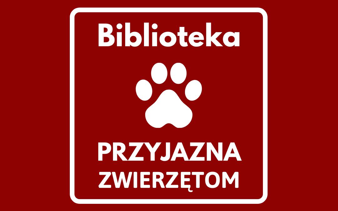 na czerwonym tle biały napis biblioteka przyjazna zwierzętom oraz odcisk łapy psa